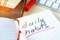 Daily habits written in a note. Daily habits written in a note by a marker Royalty Free Stock Photos