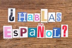 ` Hablas Espanol de question ? ` sur le fond en bois Photos libres de droits