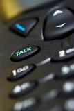 Hable el clave en un teléfono celular Foto de archivo libre de regalías