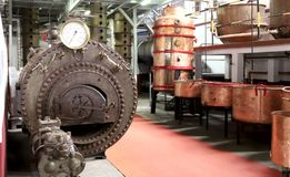 Hace compras la fábrica vieja para la producción de alcohol imagen de archivo libre de regalías