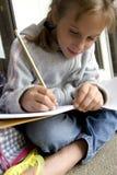 Hacer su trabajo de la escuela Foto de archivo libre de regalías