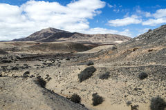 Hacha grande, montagna vicino alla spiaggia di Papagayo a Lanzarote, Isole Canarie Immagine Stock