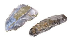 Hacha y cuchillo de piedra. Paleolithicum (CA 5,400 A.C. – Ca 3,900 A.C.) Imágenes de archivo libres de regalías