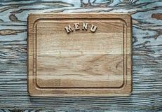 Hachoir de menu sur la surface en bois Images libres de droits