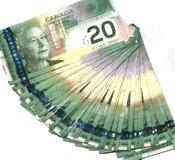 Hacia fuera aventado canadiense veinte cuentas de dólar Fotografía de archivo