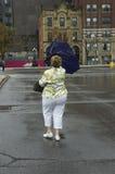 Hacia fuera paraguas soplado Imágenes de archivo libres de regalías