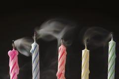 Hacia fuera velas sopladas del cumpleaños Imágenes de archivo libres de regalías