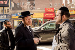 Hacidic Jews Chatting in Front of B&H Camera Store. Three Hacidic Jewish men in discussion on sidewalk in front of B&H Camera Store on 34th Street and 9th Avenue Stock Photos