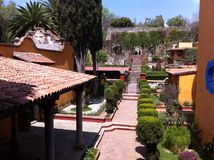 Hacienda entrance with beautiful passage between trees and stairs Royalty Free Stock Photos