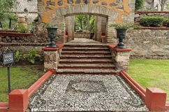 Hacienda Garden Guanajuato. A stone mosaic on the floor, a stair with an arch framed by two large ceramic vases in a typical hacienda garden Royalty Free Stock Photography