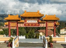 Torii entrance of Hsi Lai Buddhist Temple, California. Hacienda Heights, CA, USA - March 23, 2018: Red and ochre colored Torii enrance gate to Hsi Lai Buddhist Royalty Free Stock Photo