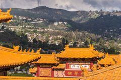 Roofs of Hsi Lai Buddhist Temple and hills, California.