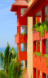 Hacienda Style Hotel. Red balconies by the sea in a hacienda style hotel Stock Image