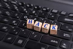 Hack on laptop. Wooden block with Hack word on laptop keyboard. hacking data concept Stock Photography