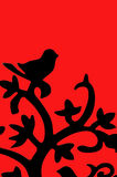 Hack made with their own hands. bird sitting on a branch. / silhouette backlit royalty free stock photography