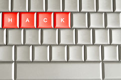 Hack spelled on a keyboard. Hack word spelled on a metallic keyboard Stock Photos