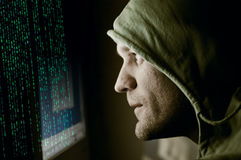 Hacker. Man in front of computer Royalty Free Stock Image