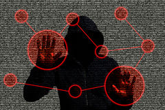 Hacker accessing a computer network. Hooded hacker infiltrating a computer network by touching a screen with red circles on a code background Stock Photos