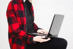 Hacker attack. breaking. girl. With a plaid blouse with a laptop on a white background. vertical orientation of the sheet stock photo
