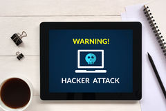 Hacker attack concept on tablet screen with office objects royalty free stock images