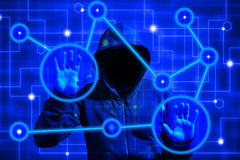 Hacker attacks computer network nodes with touchscreen. Hooded hacker infiltrating a computer network by touching a screen with blue circles influencing nodes stock image