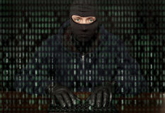 Hacker. In a balaclava with laptop royalty free stock photography