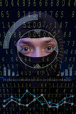 Hacker with balaclava over a screen with binary code Stock Image