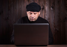 Hacker in a balaclava Royalty Free Stock Images