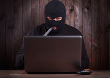 Hacker in a balaclava Stock Image