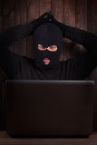 Hacker in a balaclava Royalty Free Stock Photos
