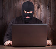 Hacker in a balaclava Stock Photos