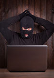 Hacker in a balaclava Royalty Free Stock Image