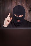 Hacker in a balaclava Stock Photography