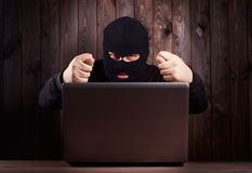 Hacker in a balaclava Stock Photo