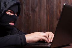 Hacker in a balaclava Royalty Free Stock Photography