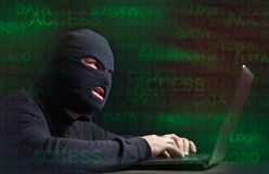 Hacker in a balaclava Stock Images