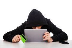 Hacker with a Bank Card Stock Image
