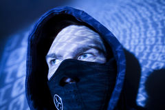 Hacker with binary background stock image