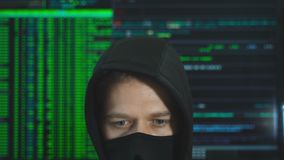 Hacker in black mask. Hacking and internet security concept stock footage