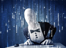 Hacker in body mask decoding information from futuristic network Royalty Free Stock Photos