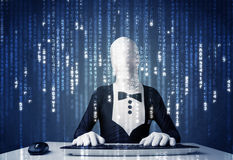 Hacker in body mask decoding information from futuristic network Royalty Free Stock Photography