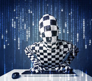 Hacker in body mask decoding information from futuristic network Stock Photos