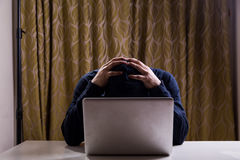 Hacker with both hands on head after failed attempt stock photography
