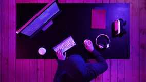 Hacker breaking the system. Top view.Hacker breaking the system. Professional shot in 4K resolution. 020. You can use it e.g. in your commercial video, medical stock footage