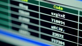 A hacker is breaking users' passwords using a brute force method. Screen with crypto code and digitals. Programm code