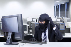 Hacker in business suit getting confused. Male hacker wearing business suit getting confused to break the computer security Stock Photos