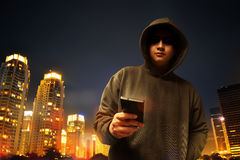 Hacker in the city. At night Royalty Free Stock Image