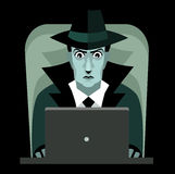 Hacker with computer black hat Stock Photo