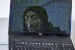 Hacker with computer monitor Royalty Free Stock Photo