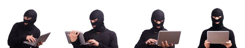 The hacker with computer wearing balaclava Stock Image
